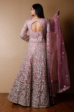 Net Gown in Pink color with Sequins, Stone, Zari work.