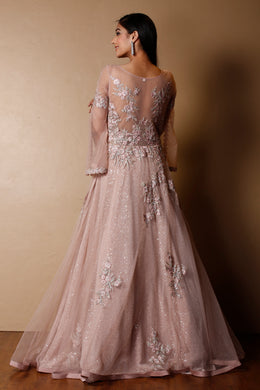 Net Gown in Pink color with Sequins, Stone, Thread work.