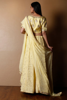 Lucknowi Georgette Lehenga in Yellow color with Gota Patti, Mukesh Work, Swarovski work.