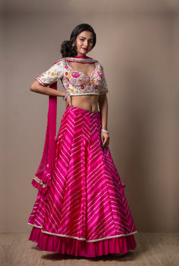 Rani Pink color Leheriya Lehenga with Gota Patti, Zardozi, Thread & Applique work.