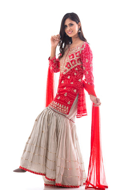 Suits in Red color with Gota Patti, Bandhej work.