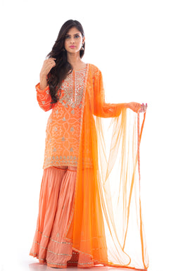 Suits in Orange color with Gota, Bandhej work.