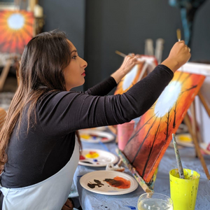Woman paints acrylic painting of autumn inspired artwork