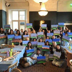 group poses with their paintings of the London skyline