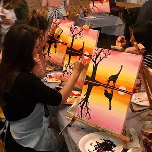office employees painting a sunset safari canvas painting