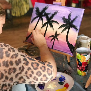 girl painting a palm tree sunset painting
