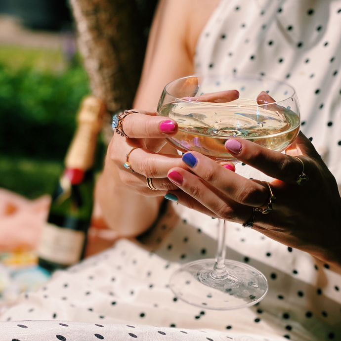 woman holding a glass of prosecco