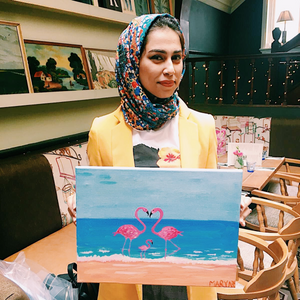 woman holding her beginner friendly flamingo painting