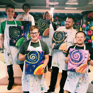 co-workers holding their outerspace galaxy paintings after an office party