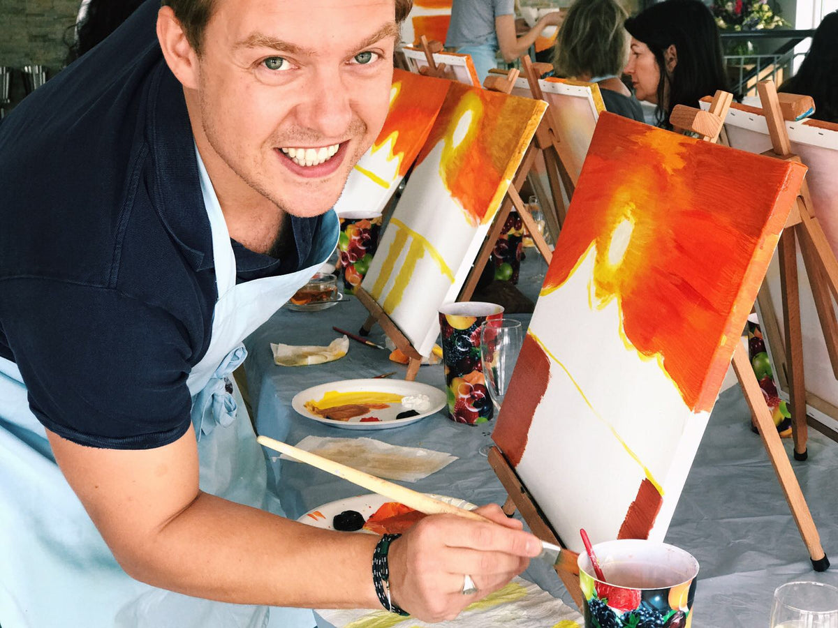 man smiling during a brush and bubbles painting event