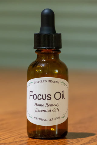 1 oz amber bottle with label reads:  Inspired Health Focus Oil Home Remedy Essential Oils Natural Healing.