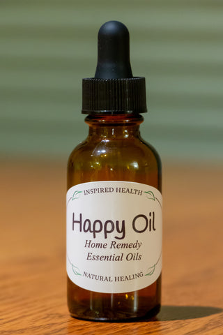 1 oz amber bottle with label reads: Inspired Health, Happy Oil, Home Remedy, Essential Oils, Natural Healing