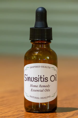 1 oz amber bottle with label reads: Inspired Health, Sinusitis Oil, Home Remedy, Essential Oils, Natural Healing