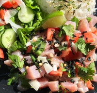 "Da ""T Souz"" - Our only poke made with fresh Mahi Mahi  Prepared ceviche style marinated in fresh lime, tomato, onion, cilantro and fresh jalapeno slices"