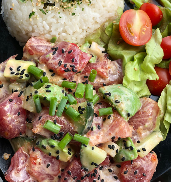 "Da ""Mo-Mo"" Our ""kinda"" spicy ahi poke with Maui onion, fresh avocado, cucumber, lunch lady spicy mayo and topped with green onion"
