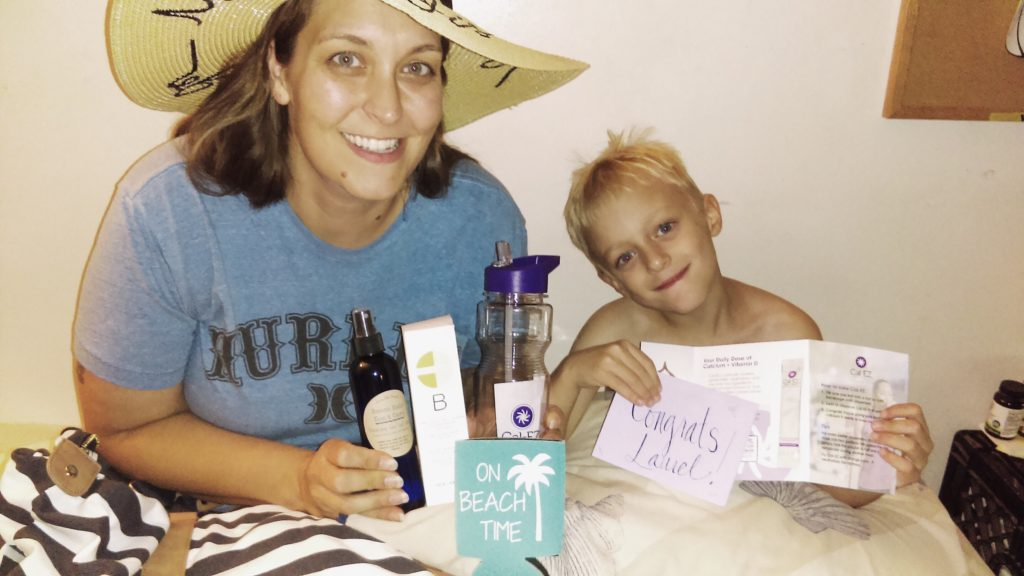 Laurel, winner of the Cal-EZ Summer Lovin' Beach Tote Giveaway, and her son showing off their loot!
