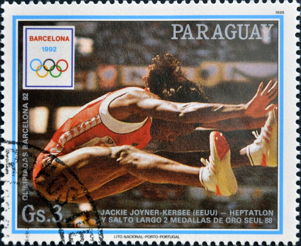 """Jackie Joyner-Kersee 1989 Paraguay stamp"" by Unknown - <1> <2>. Licensed under Public Domain via Commons - https://commons.wikimedia.org/wiki/File:Jackie_Joyner-Kersee_1989_Paraguay_stamp.jpg#/media/File:Jackie_Joyner-Kersee_1989_Paraguay_stamp.jpg"