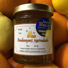 Load image into Gallery viewer, Champion Beekeepers Marmalade. Cedrics Champion Award Winning Beekeepers Marmalade. Made by Hand at Cedrics in Somerset, England in tiny batches.  Oranges and Somerset Honey.