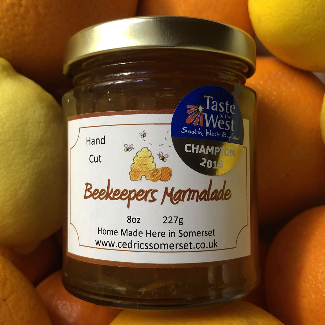 Champion Beekeepers Marmalade. Cedrics Champion Award Winning Beekeepers Marmalade. Made by Hand at Cedrics in Somerset, England in tiny batches.  Oranges and Somerset Honey.