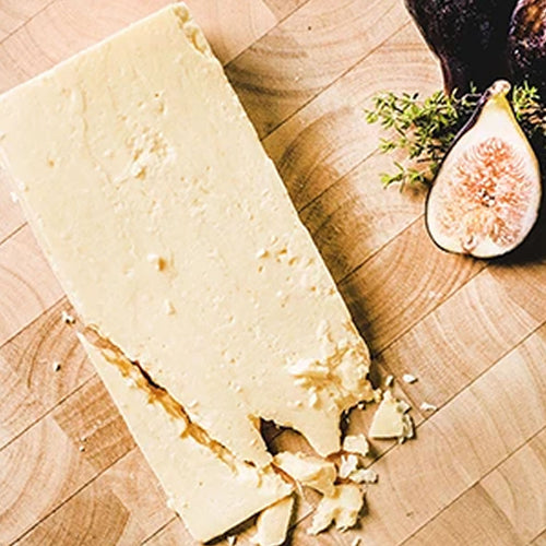Local Somerset 24 month Matured Cheddar Cheese made using traditional starter cultures and the finest West Country milk. It has an unrivalled complexity and depth, savour it as part of a cheeseboard with Cedrics award winning Jelly and Chutney and a glass of Cedrics Cider