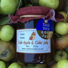 Load image into Gallery viewer, Crab apple and Cider Jelly. Our 'Taste of the West' 2013 Gold Award Winning Jelly.  A Somerset twist on a delicious rosy pink old favourite,  Serving Suggestion: Perfect partnered with cold pork and cheese!  Made by Hand at Cedrics in Somerset, England in tiny batches.