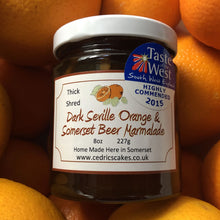 Load image into Gallery viewer, Dark Seville Orange and Somerset Beer Marmalade. Our 'Taste of the West' 2015 Award Winning Marmalade.  Organic Seville Oranges and Somerset Beer combines to create a dark and delicious marmalade.  Serving Suggestion: Salutes Breakfast in style - Delicious on hot buttered toast  Made by Hand at Cedrics in Somerset, England in tiny batches.