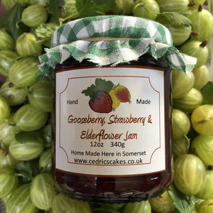 Gooseberry, Strawberry and Elderflower Jam. A marriage of decedent hedgerow flowers and summer fruit, combine to make an extraordinarily tasty and fragrant jam. Delicious!  Serving Suggestion: Try me thickly spread on freshly baked Scones!  Made by Hand at Cedrics in Somerset, England in tiny batches.