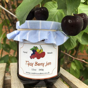 Tipsy Berry Jam. A very delicious dark, rich jam made from plump Blackcurrants, Cherries, Gooseberries and Redcurrants and finished with local Somerset Morello Cherry Liqueur.  Serving Suggestion: Delicious on hot buttered toast and teatime cakes.  Made by Hand at Cedrics in Somerset, England in tiny batches.