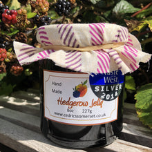 Load image into Gallery viewer, Hedgerow Jelly. Our 'Taste of the West' 2014 Silver Award Winning Jelly.  A hedgerow jelly.  Serving Suggestion: Perfect with cooked meats or just as delightful on warm toast as a seedless jam!  Made by Hand at Cedrics in Somerset, England in tiny batches.