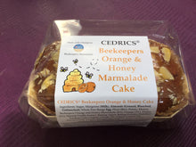 Load image into Gallery viewer, Cedrics Beekeepers Orange & Honey Marmalade Cake. Our 'Taste of the West' 2019 Gold Award Winning Cake, made with Champion beekeepers Marmalade. Made by Hand at Cedrics in Somerset, England in tiny batches.
