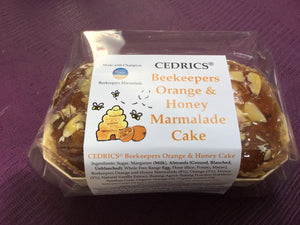 Cedrics Beekeepers Orange & Honey Marmalade Cake. Our 'Taste of the West' 2019 Gold Award Winning Cake, made with Champion beekeepers Marmalade. Made by Hand at Cedrics in Somerset, England in tiny batches.