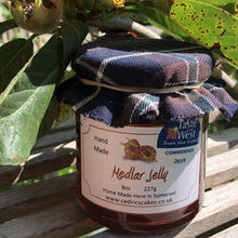 Load image into Gallery viewer, Medlar Jelly.  Our 'Taste of the West' 2019 Highly Commended Award Winning Jelly.  A lovely fruity Jelly made with Medlars and Apples  Serving Suggestion: Try me on Roast Pork, or with a Cheese board!    Made by Hand at Cedrics in Somerset, England in tiny batches.