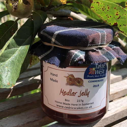 Medlar Jelly.  Our 'Taste of the West' 2019 Highly Commended Award Winning Jelly.  A lovely fruity Jelly made with Medlars and Apples  Serving Suggestion: Try me on Roast Pork, or with a Cheese board!    Made by Hand at Cedrics in Somerset, England in tiny batches.