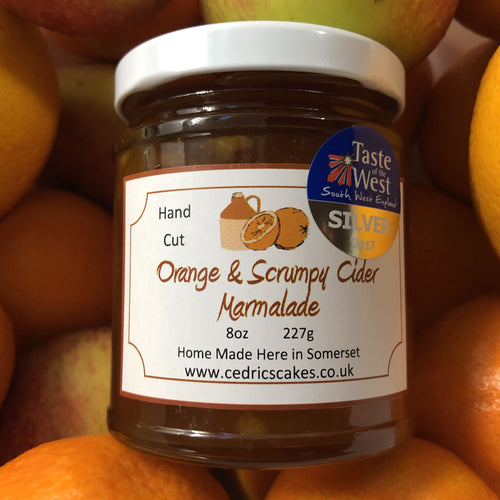 Orange and Scrumpy Cider Marmalade. Our 'Taste of the West' 2017 Silver Award Winning Marmalade.  A fabulous Marmalade made with Sweet Oranges and Traditional Somerset Scrumpy Cider, yummy!  Serving Suggestion: Delicious on hot buttered toast!  Made by Hand at Cedrics in Somerset, England in tiny batches.