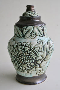 Porcelain Urn with Sunflower Carving