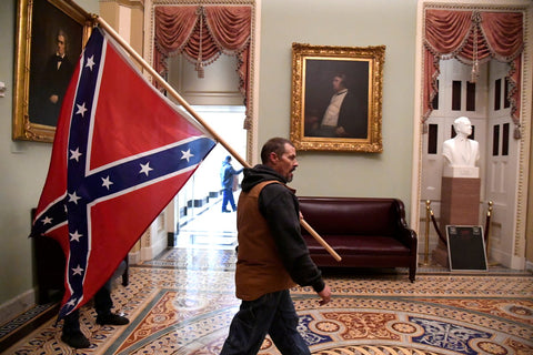 Trumper walking with Confederate flag in the White House - via PBS