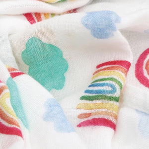Willow and Lune's rainbow dream muslin square. Gorgeous bright and fun print with rainbows, clouds and the sun