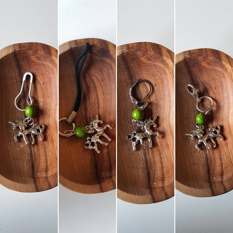 Four stitch marker options are photographed separately and compiled into one image side by side. Each option is photographed on a wooden dish from above.