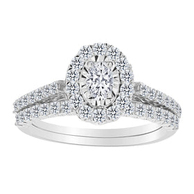 .33 CARAT OVAL SHAPE CENTRE, 1.00 CARAT TOTAL DIAMOND RING SET, 14kt WHITE GOLD....................NOW