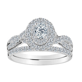 .23 CARAT OVAL CENTRE, 1.00 TOTAL DIAMOND HALO ENGAGEMENT RING SET, 14kt WHITE GOLD.......................NOW