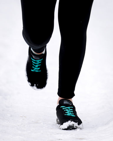 Blue shoelaces on black running shoes