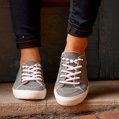 Grey shoes with white no tie shoelaces