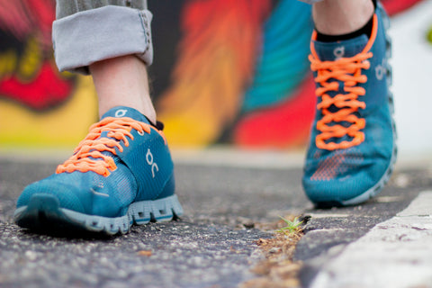 Walking in the city with blue sneakers and citrus no tie shoelaces