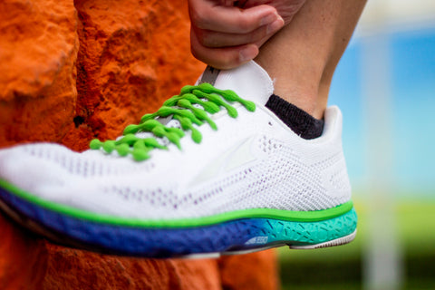 Green Shoelaces on White Running Shoes