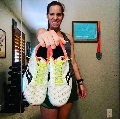 Female runner with running shoes and no tie shoelaces in electric yellow