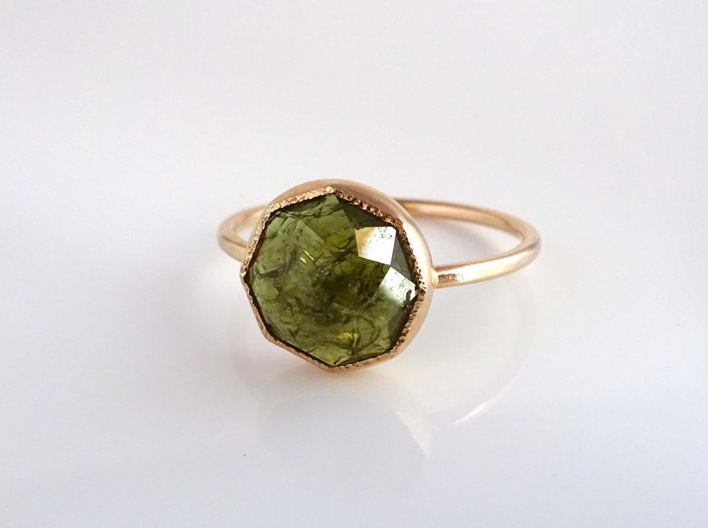 The Green Garnet Stacker Ring features Michelle's dahlia faceting and signature details