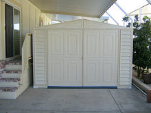 Load image into Gallery viewer, Duramax Vinyl Garage 10.5'x15.5' includes Foundation Kit