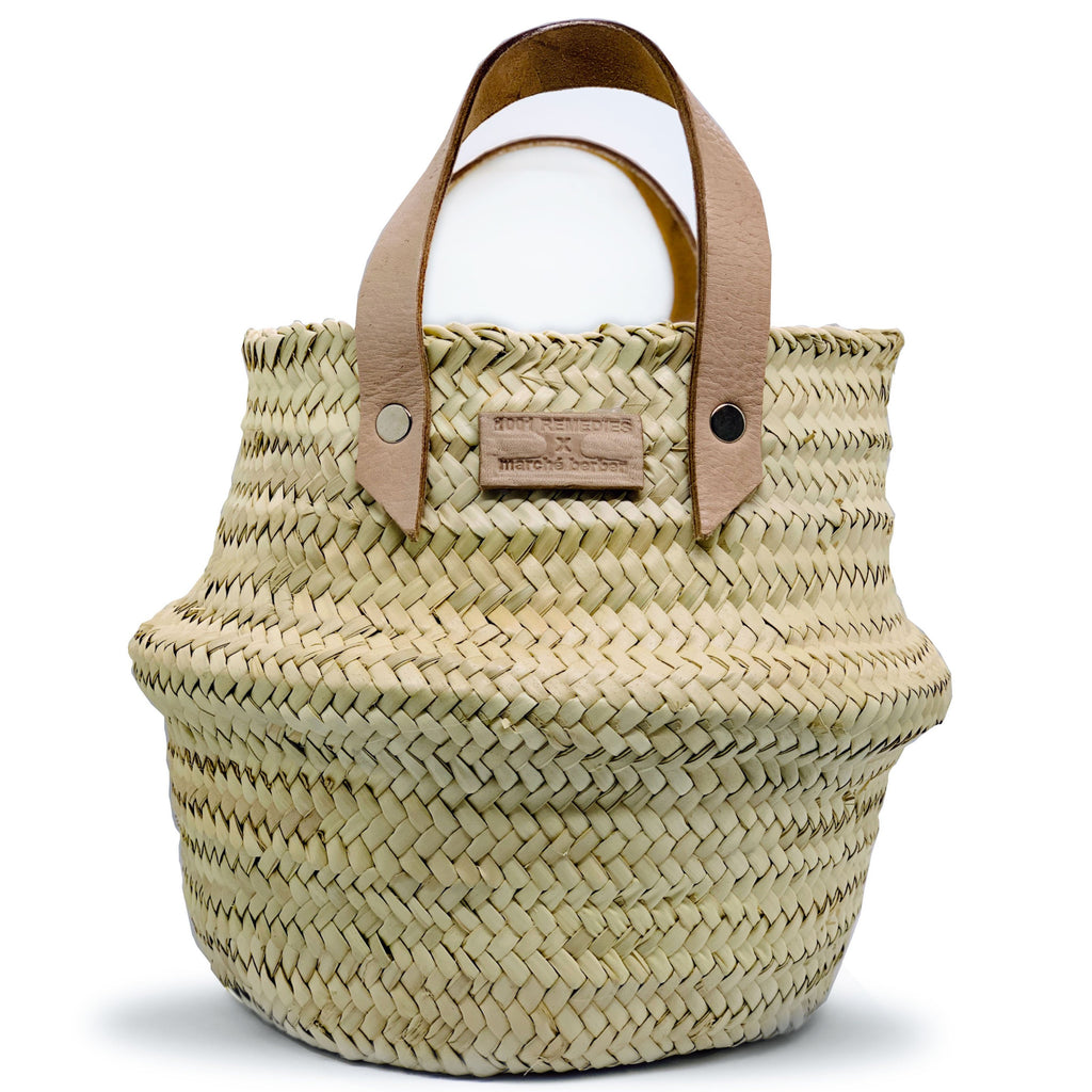Hand woven basket with goatskin handles