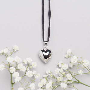 silver plated heart shaped Mexican bola pregnancy necklace with black hand dyed silk cord