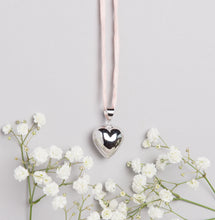 Load image into Gallery viewer, Silver plated heart Mexican bola pregnancy necklace with baby pink hand dyed silk cord
